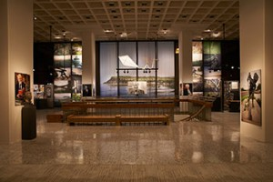 """The kite that hangs in the center of the exhibit evokes the """"long-tailed pull of grief"""" from Heaney's poem """"A Kite for Michael and Christopher."""" Installation view """"Seamus Heaney: The Music of What Happens"""" Exhibition."""