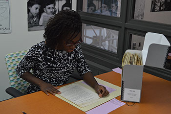 "Morgan Monroe researches her undergraduate honors thesis ""Mixed Messages: An Analysis of Correspondence and Representations of Josephine Baker."""