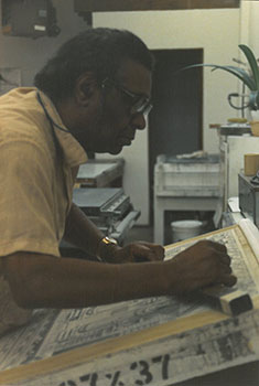 John Biggers working on sketches for murals.