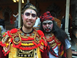 Ryan Sutherland poses with a man in traditional Balinese garb while dressed in the costume of Baris. Courtesy of Ryan Sutherland.