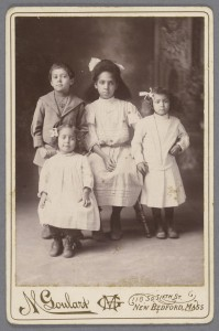 """Three girls in dresses and bows in their hair, one little boy,"" Robert Langmuir African American photograph collection."