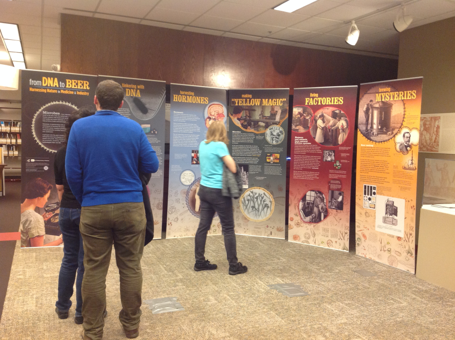 "Event attendees view the ""From DNA to Beer"" Traveling exhibit in the Woodruff Health Sciences Library."