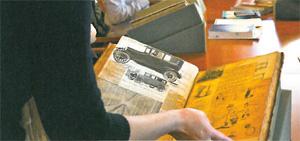 Students look at scrapbooks