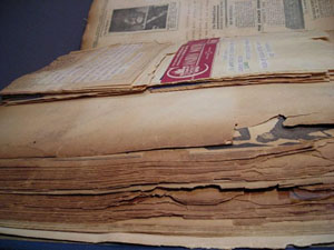 Side view of the scrapbook created by vaudeville performer Johnny Hudgins, revealing the enormity of the book and the brittle nature of its pages.