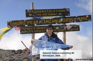Deborah Atwood summiting Mt. Kilimanjaro, 2009