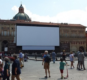 A daytime view of the outdoor movie screen on the Piazza Maggiore in Bologna