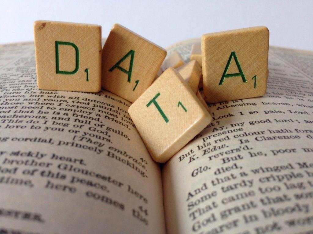 Letter tiles spelling data on a book