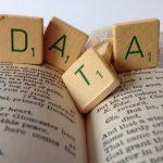 data letter tiles on book