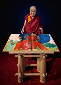 Dalai Lama with Murals of Tibet