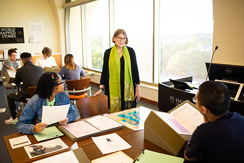 Emory associate history professor Judith Miller talks with students in her Fake News seminar during its Rose Library session.