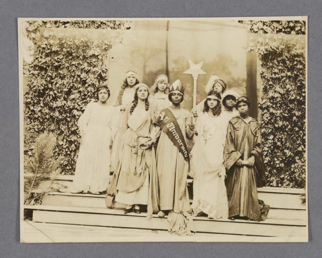 Students at Clark Atlanta University dressed in costume holding a star