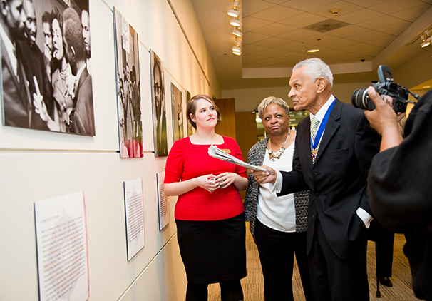 Rev. C.T. Vivian tours the SCLC exhibition in 2013 with two of the co-curators, Sarah Quigley (left), Rose Library head of collections processing and the project archivist for the SCLC collection, and Carol Anderson, Charles Howard Candler Professor and chair of African American Studies at Emory.