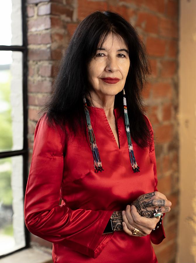 U.S. Poet Laureate Joy Harjo wearing red blouse.