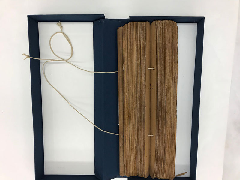 The Telugu Manuscript is its protective box created by the Emory Libraries' preservation staff.