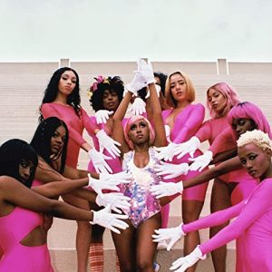 Yung Baby Tate with other women dressed in pink on the cover of the 2019 album Girls
