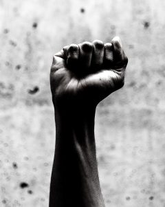 Black and white photograph of a raised fist
